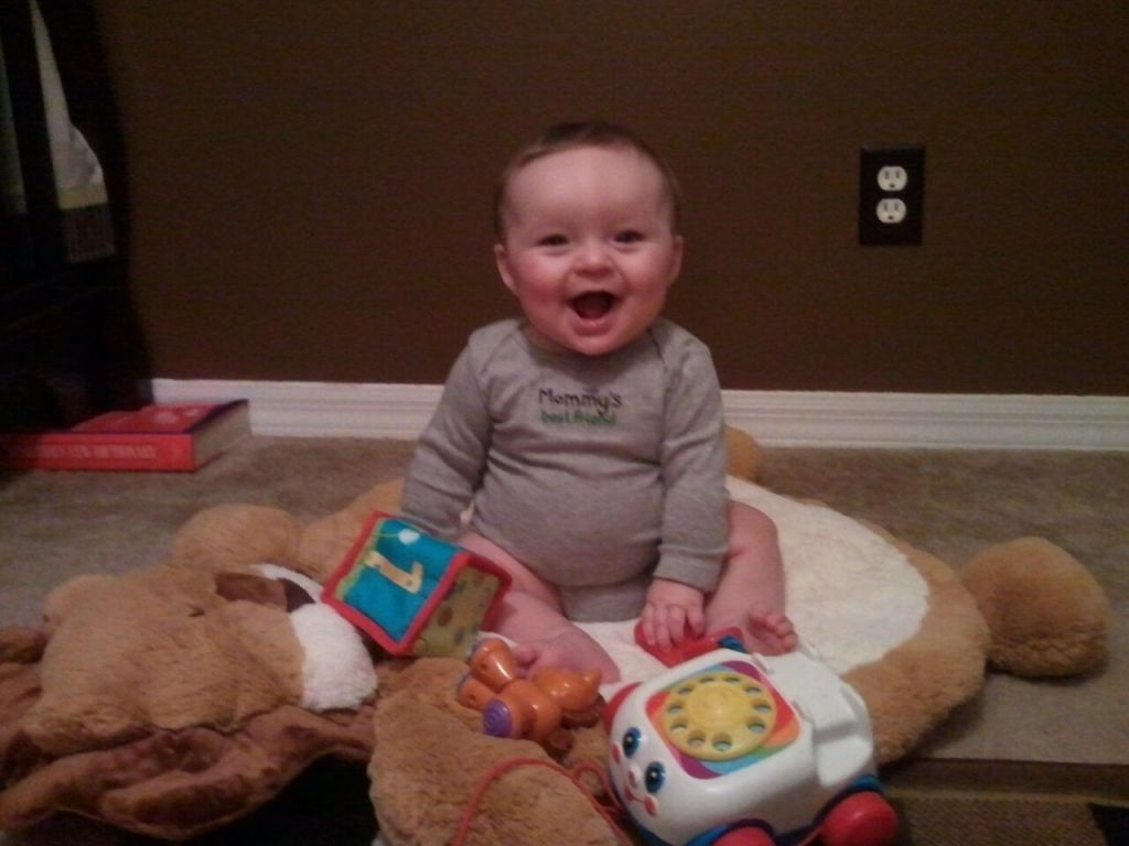 3.01.12 ~ approx. 7 months old ~ classic example of our proud & happy little man who was just learning to sit up at this pt