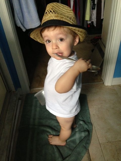having some fun with daddy's hat after breakfast...too cute for words