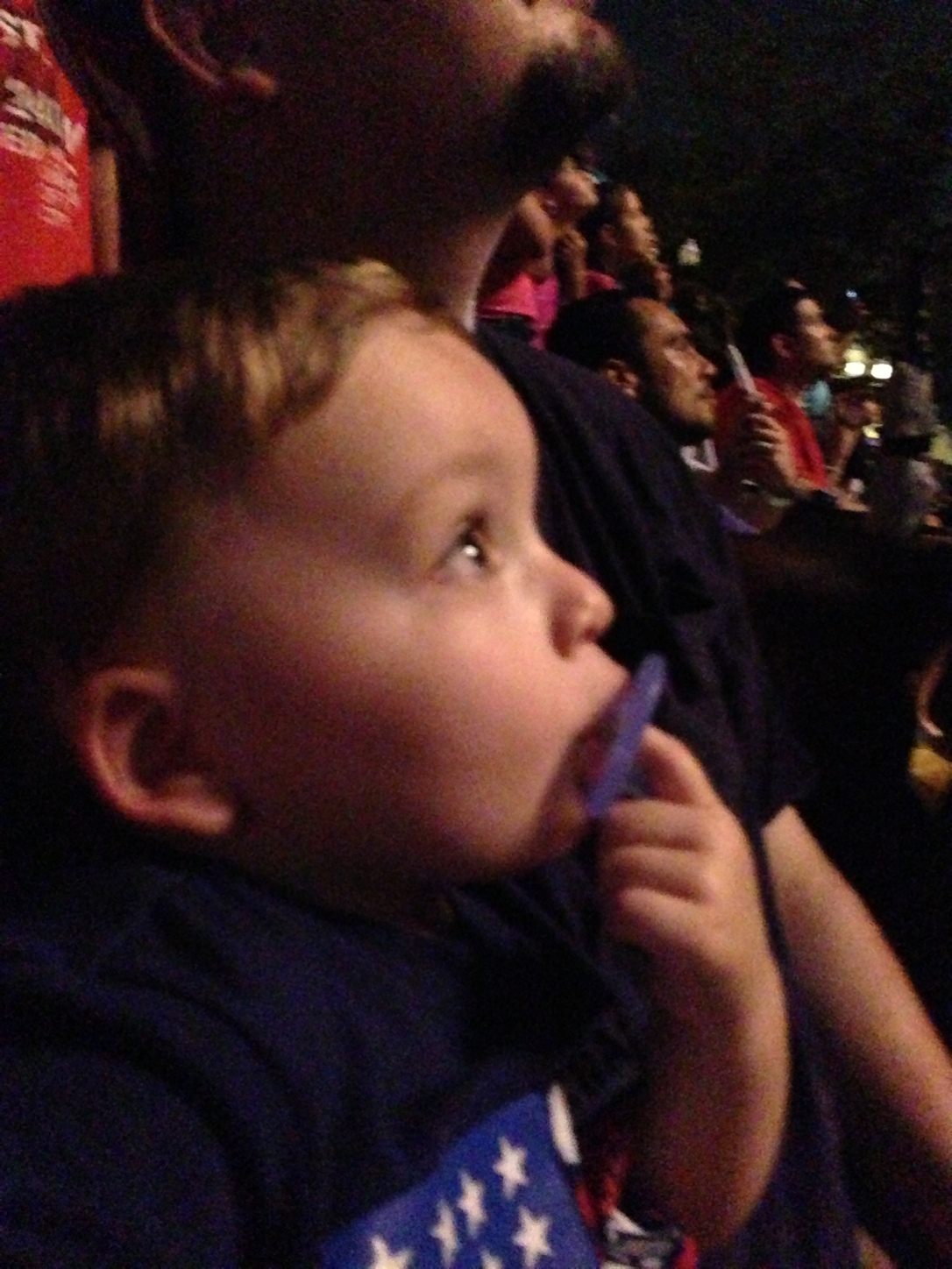 "Captivated...Watching the ""MAGIC"" in the sky while safely sitting in Daddy's embrace :)"